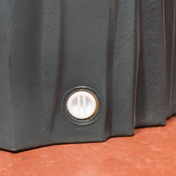 metal threaded port at the base of the water butt